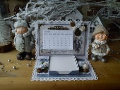 Une carte chevalet calendrier par Athéna  ( papiers Maja Design ) + info