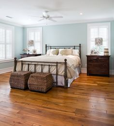 The cool coastal blue Sherwin-Williams wall paint creates a relaxing aura and provides the perfect backdrop for the room's many seaside inspired accents.