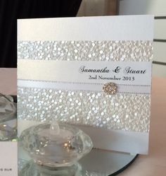 Our Grand Affair Invitation is perfect for a white glamour wedding theme. A embossed paper the diamonte rosette trim as both texture and sparkle. See it on line at www.somethingfabulous.com.au. A fabulous white wedding invitation. #whiteweddinginvitation