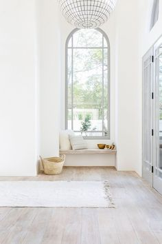 This window nook is a beautiful combination of neutrals. The white oak floors are beautiful with the gray painted woodwork. It is a soft look that creates high impact.
