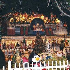 "Photo: Patricia Farmer | thisoldhouse.com | Not sure if you can tell, but Patricia Farmer in Alexandria, Virginia, has an extensive collection on yard inflatables. Her display includes a giant snow globe, hundreds of candy canes hanging from trees, and a ""toy shop"" on the front porch."