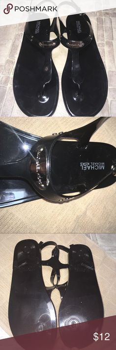 """Michael Kors sandals Black pair of Michael Kors sandals size 11. These are the """"jelly"""" type made of pvc (plastic). They are all black except for the name plate on front strap that is silver. Almost new condition. MICHAEL Michael Kors Shoes Sandals"""