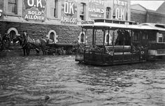 A cable tram negotiating flood waters by the OK Jam Factory in South Yarra, 1907. Photograph courtesy Museum Victoria.