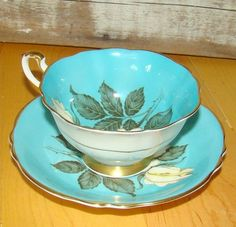 Paragon Tea Cup and Saucer Turquoise blue with white rose | eBay