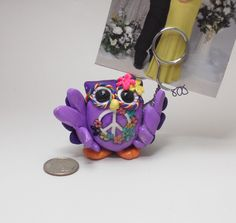 Purple peace owl picture holder of polymer clay via Etsy.