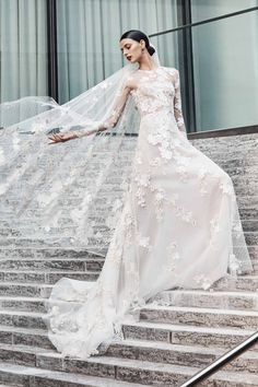 9d093e9e6545 Naeem Khan Bridal s Fall 2019 Line Features Sleek Designs Wedding Dress  With Feathers