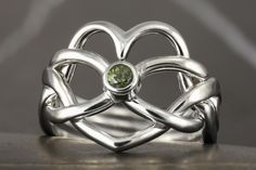 Green sapphire heart shape puzzle ring