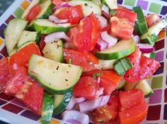 "Tomato, Cucumber and Red Onion Salad from Food.com: ""Refreshing light summer salad."" I like to make this salad in the Summer when my Tomatoes, and Basil are plentiful and Cucumbers are 3 for a dollar at the Grocery stores and farmers markets! A very pretty healthy salad. Try it I don't think you will be dissapointed!"