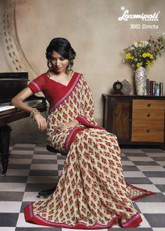 Beautifully Designed Flower Printed Geogette saree with Jari work on its Border.
