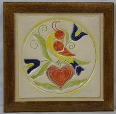 """Handmade Pennsylvania Dutch Ceramic Framed Gift Tile. This traditional Handmade Pennsylvania Dutch Hex Ceramic tile displays the """"Distelfink"""", a thistle eating gold finch. Pennsylvania Dutch Hex symbols were often painted on the outside of barns for not only decoration but with hopes of good luck and fortune. The Distelfink Hex symbolizes good luck and happiness. The heart and tulips add a little love and faith to the mix. This would be a perfect gift for a wedding or a house warming! The..."""