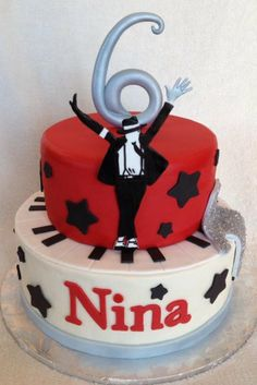 """Michael Jackson cake with all edible fondant accents including """"Michael"""", the piano, the glove and the number 6."""