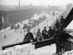 Workmen break for lunch on girders at Unilever House, Blackfriars, London.  (Photo by Fox Photos/Getty Images). 9th April 1931