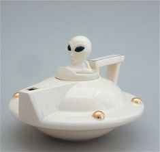Andy Titcomb Creme UFO Teapot. Approximately 7'' long by 7'' wide by 7'' tall. $84.00