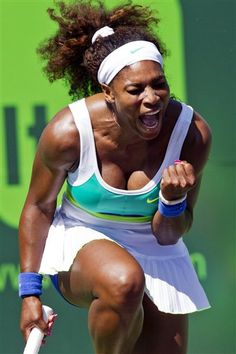 Serena Williams reacts to a shot against Flavia Pennetta, of Italy, during the Sony Open tennis tournament, Thursday, March 21, 2013, in Key Biscayne, Fla. (AP Photo/The Miami Herald, C.W. Griffin)