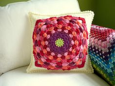 Beautiful colours. Pattern here: http://www.ravelry.com/patterns/library/flower-power-pillow