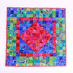 """When Amish Meets Colorwash, Rowan Kaffe Collective 2 ½"""" Squares  The intensity of the colors and values of light and dark within the Rowan Kaffe Collective (Kaffe Fassett, Brandon Mably, Philip Jacobs), lend themselves to Watercolor quilts, especially when cut into small squares. This quilt, When Amish Meets Colourwash, uses Rowan's new 2 ½"""" Squares in two color ways – Hot and Cool.  The Rowan Kaffe Fassett Collective 2 ½"""" Squares feature 250 pieces in four color ways-Hot, Cool, Light and…"""