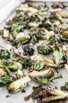 """Kale sprouts """"Kalette"""" are a beautiful cross between Brussels Sprouts and Kale. Kale Sprouts with Roasted Garlic & Parm Recipe ~ http://steamykitchen.com"""