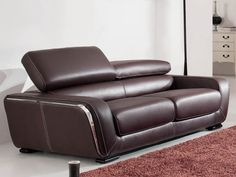 "ESF 2750 Sofa - Modern designer full leather sofa. Full brown Italian leather sofa is designed with style in mind. Double stitched on the sides, oversized adjustable headrests and metal insert give this sofa absolutely unique look. Measurements: L87""x D42""x H36""."