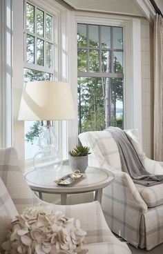 This lakeside bedroom seating area features two wingback chairs and pale gray accent table. Bedroom Seating, Living Room Seating, Living Room Decor, Bedroom With Sitting Area, Sunroom Decorating, Elegant Home Decor, Luxury Interior Design, Home And Living, Living Room Designs