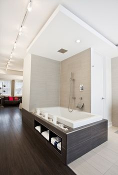 i know we want to minimize the footprint of bath tub...but if we do end up with a ledge..I would offset it so there is more ledge on the interior side (make it mini-bench) and this towel storage could be cool. (would we consider raising the tub)?  oh BTW...floors our sweet.