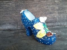 Check out this item in my Etsy shop https://www.etsy.com/listing/128701423/retro-hand-painted-porcelain-shoe