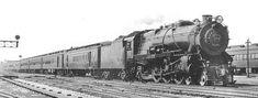 Pennsylvania Railroad K 4 class Pacific steam locomotive on a passenger train. Circa 1930's.