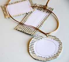 love this idea - use old book pages and then sew on a paper label for a creative home stitched gift tag