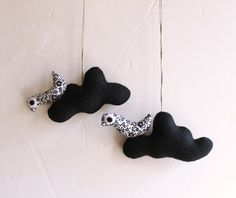 Two black clouds with birds. Felt Decoration wall hanging.