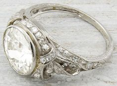 Edwardian/early Art Deco engagement ring, circa 1905.  Set with 2.33 carat EGL certified old European cut diamond with H-I color and SI1 clarity. Via Diamonds in the Library.