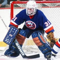 """Billy Smith was the cantankerous netminder for the New York Islander dynasty of the late and early Affectionately called """"Hatchet Man"""" for his liberal stick work, Smith notably excused himself from postgame handshake lines because of his emotional nature. Ice Hockey Teams, Hockey Goalie, Hockey Games, Hockey Stuff, Nhl, Goalie Mask, Carolina Hurricanes, New York Islanders, National Hockey League"""
