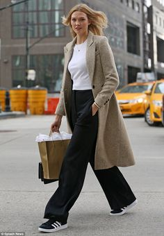 She's learned from the best:Karlie Kloss gave a lesson in off-duty dressing as she headed to a fashion meeting in a pair of wide-legged trousers teamed with trainers in New York City on Wednesday