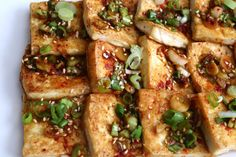 Pan fried tofu with spicy sauce. Korean tofu side dish