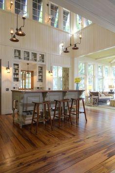 Floors change in direction; color... Wow! Lighting, wood floors, windows! Beautiful!... Like the windows, floor & walls.... direction of flooring for division of space... huge space!