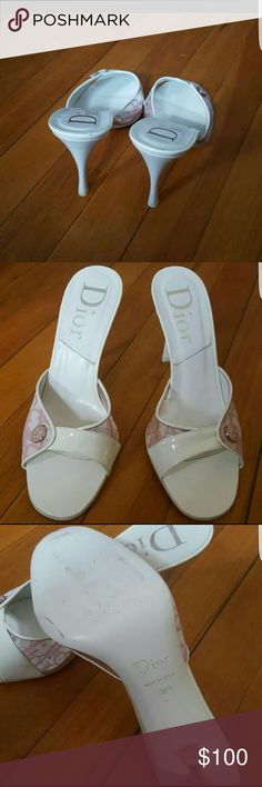 Christian Dior high heel sandal Pre -owned and authentic. White and pink. Small scratch on the left top heel. One side is plastic and the other is canvas. Made in Italy. Retail: $400.00. Open to offer Christian Dior Shoes Sandals
