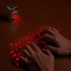 Laser keyboard: works with Mac, iPhone, and iPad!
