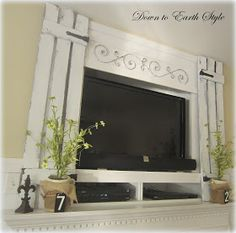 Down to Earth Style: Easy and beautiful way to decorate around the flat screen hung on the wall. GREAT IDEA!!