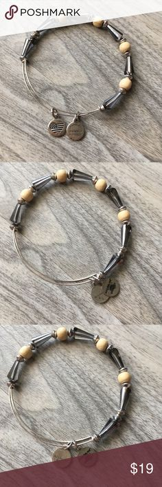 Alex and Ani seeds of promise Alex and Ani seeds of promise. Been sitting in my closet. Still has life. I've never worn. Don't know why there are dark marks? Really pretty Alex And Ani Jewelry Bracelets