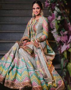 Love this bright multi-coloured sharara lehenga by Rimple & Harpreet Narula. Bridal Mehndi Dresses, Indian Wedding Gowns, Mehendi Outfits, Pakistani Wedding Outfits, Indian Bridal Wear, Wedding Dresses For Girls, Bridal Outfits, Pakistani Dresses, Indian Dresses