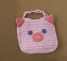 piggy bib, also cute owl and froggie on their website