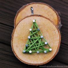 This rustic DIY Wood Slice String Art Ornament is simple to make and looks beautiful on the Christmas tree. Give as a gift or add to the top of a present for a creative giftwrap idea. Inspired by a Christmas children's book, this kid's Christmas ornament