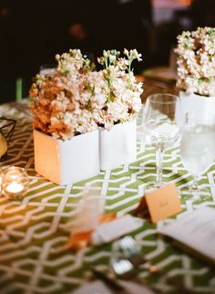 a mix of geometric patterned linens and sleek white vases  Photography by aliharperphotography.com, Planning by estoriasocial.com, Floral Design by boldamerican.com