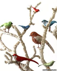 Stars twinkle against a darkened wintry sky. Tiny lights shimmer in shop windows. At this time of year, everything seems to gleam. Echo this holiday luster at home with this bird centerpiecebedecked with tinsel and glitter.