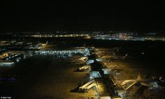 The total size of Heathrow is 4.6 square miles, pictured here is the view over Terminal 3 with Terminal 4 in the distance, with many of the aircraft undergoing engineering work having parked up for the night
