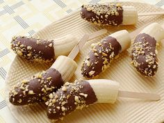 Chocolate Covered Bananas: 4 ripe medium frozen bananas, 3 tablespoons finely chopped lightly salted peanuts 6 ounces chocolate (60 to 70 percent cocoa solids), chopped. Put banana on Popsicle sticks. Dip each frozen banana into the chocolate, turning it to coat, and immediately roll in the peanuts. Place on a tray covered in waxed paper; refreeze until set.