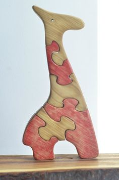 Вот такой жираф из разноцветных пазлов.
