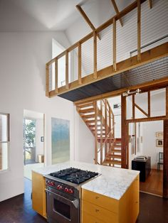 stairs along a wall to create an alternative and open (loft-like) entry to the 2nd floor