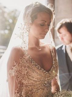 Jewel-encrusted bodice on the champagne wedding gown.
