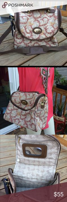 """Vintage DVF Tapestry Carry On Weekend Bag Luggage Vintage Diane Von Furstenberg brown, blush, taupe & cream colored tapestry carry on bag  Previously owned in good vintage condition: very light, normal wear. See photos for full detail.  Measures 10"""" high / 13.5"""" wide / 9.5"""" deep  Ships same or next business day! Diane von Furstenberg Bags Travel Bags"""