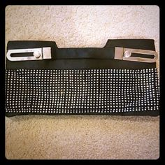 Rhinestone studded clutch Black satin clutch bag with rhinestone studs all over the front. Comes with a long chain shoulder strap. Never used. Bags Clutches & Wristlets