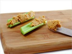Ants on a Log Serves 6  6 celery stalks, trimmed ½ c + 1 Tbsp peanut butter, preferably organic 6 Tbsp raisins  FILL each celery stalk with 1½ Tbsp of the peanut butter and sprinkle with 1 Tbsp of the raisins.  HALVE crosswise and serve.